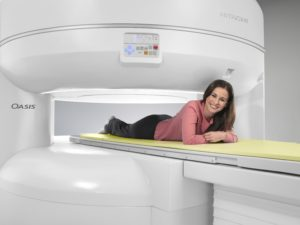 patient lying on Open MRI machine table